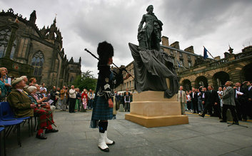 Walk down the Royal Mile and Visit Adam Smith's Statue
