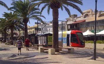 Take the tram from Adelaide to Glenelg.
